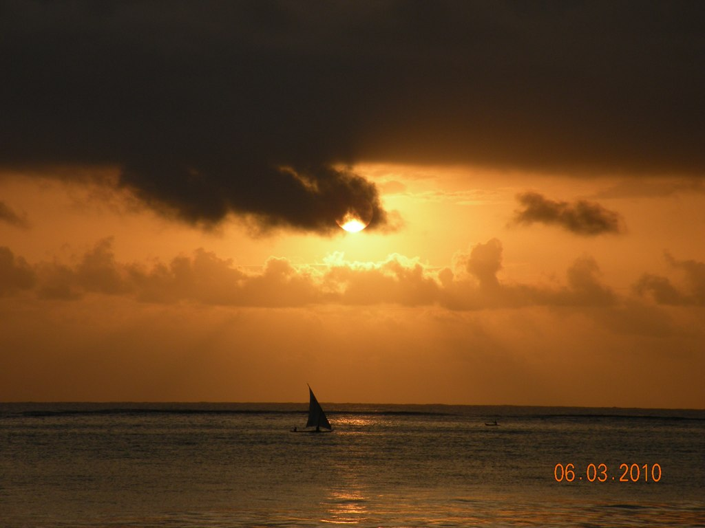 Sunset with a dhow in the distance